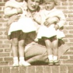 VG as a child, with her mother and sisters outside the house